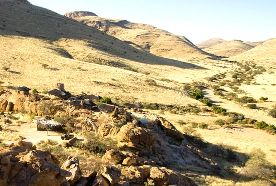 Camp with river bed in distance: View onto Kobo Kobo Hills Mountain Camp. Central Namibia