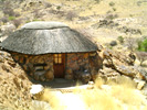 Little tucked away cottage: The Finch House – Hobbit House. Namib desert mountains
